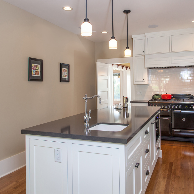 craftsman kitchen, neutral taupe, white cabinets, black counter, neutral wall