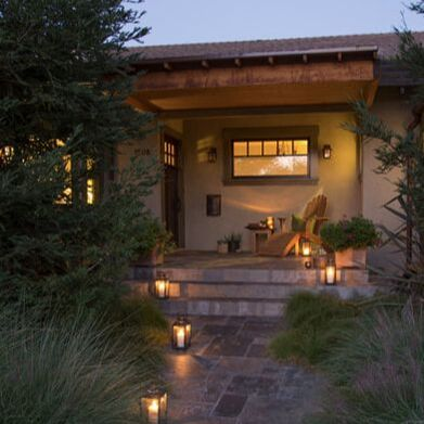 Pasadena craftsman exterior in a classic color palette of pale sage green, dark sage green trim and deep plum accent