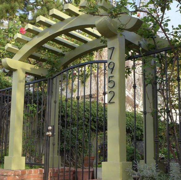 fun and fresh new green paint color on entrance pergola provides a needed update