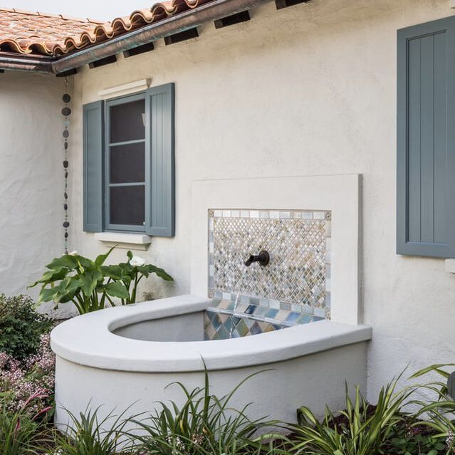Santa Barbara classic Spanish exterior color palette with sparkling tiles on fountain